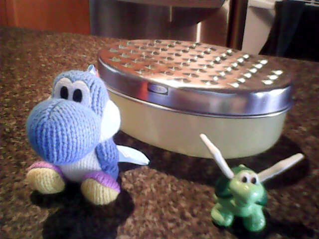 Yarn Yoshi, a Koopa Paratroopa and a Cheese Grater